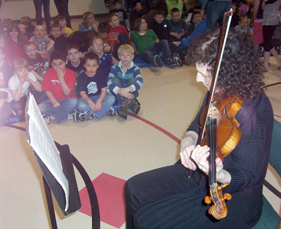 Linda Rosenthal, performing on her Italian-made violin, in a school concert at Tustumena School, March 2010.