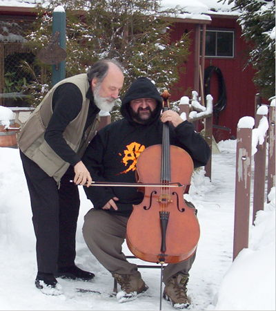 Paul Rosenthal assists Armen Ksajikian with his cello bow.